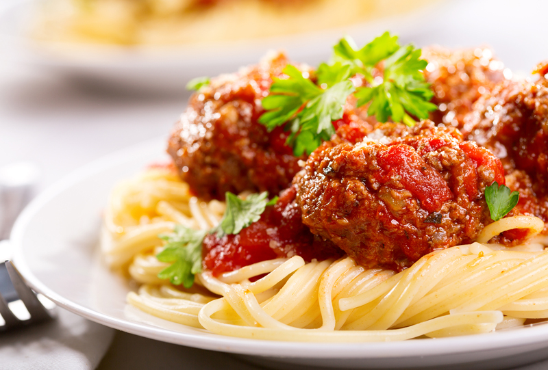 pasta with meatballs and parsley with tomato sauce